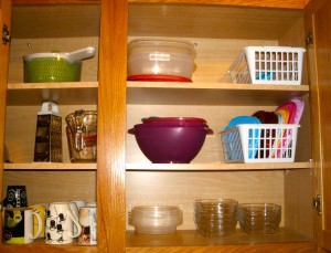 Upper cabinets...food storage containers, salad spinner, measuring cups, and grater.