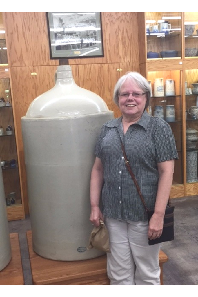 NO.2 SIS STANDING BY WORLD'S LARGEST JUG
